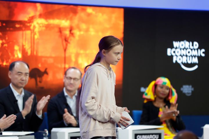 Panel members applaud for Greta Thunberg after she addressed guests at the forum's 50th annual meeting in Davos.