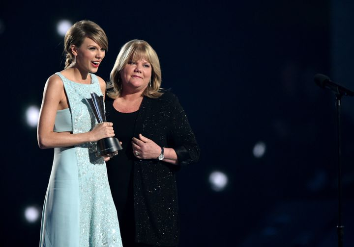 Taylor Swift and her mother, Andrea Swift, onstage during the 50th Academy of Country Music Awards in 2015.