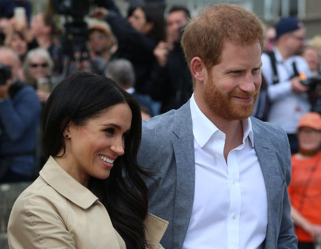 Prince Harry The Duke of Sussex with Meghan Markle the Duchess of Sussex on Day Three of their tour of...