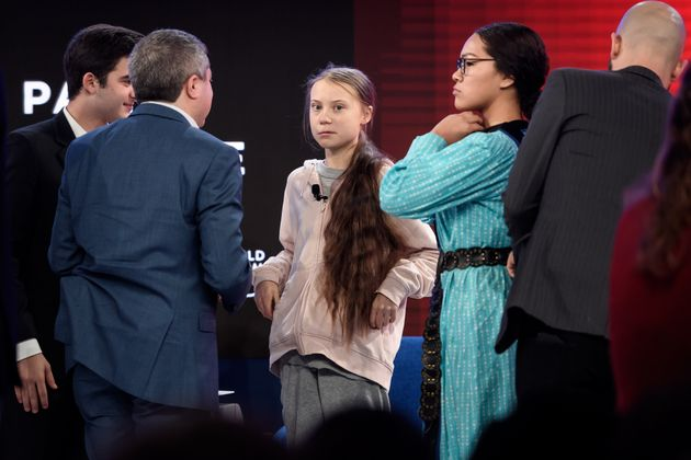 Swedish climate activist Greta Thunberg (centre) and Autumn Peltier attend a session during the World...
