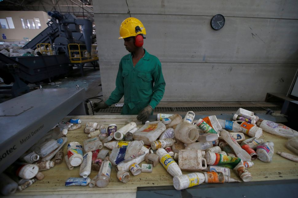An employee sorts plastic waste before being processed at a plastic recycling factory in Nairobi, Kenya.