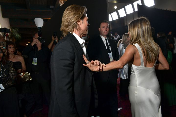 The photos -- especially the one of Pitt reaching for Aniston's hand -- made a splash online over the weekend.