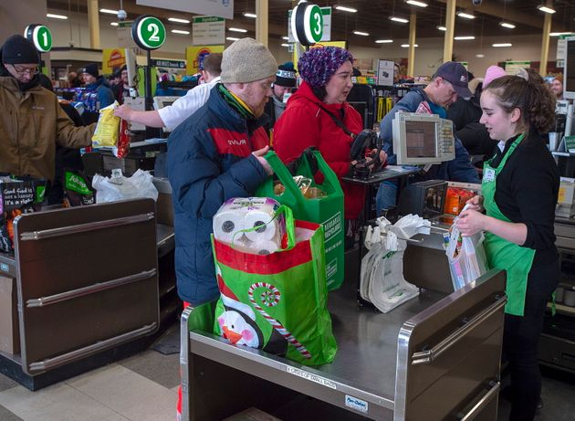 Customers purchase their food at a Sobeys grocery store in St. John's on Jan. 21,