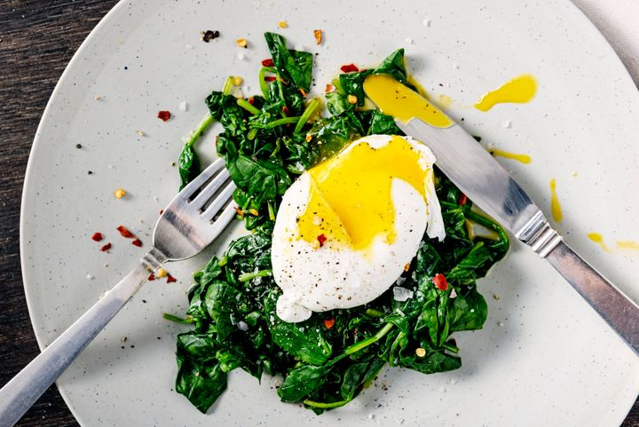 That bed of spinach will only release histamines and make a cold worse, but the egg can actually be good for a sore throat.