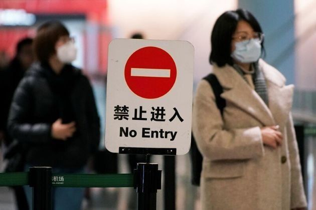 Passengers wearing masks are seen at Hongqiao International Airport in Shanghai, China January 20,