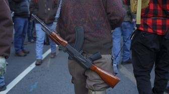 A protester has a AK slung around his shoulders. There were hundreds of guns and people open carrying near the capitol grounds during a rally organized by The Virginia Citizens Defense League on January 20, 2020 in Richmond, Virginia. Right-wing and right-leaning protesters assembled in Richmond Virginia to protest the Governor for being caught in Blackface and for supporting legislation against easy to access gun ownership.  (Photo by Shay Horse/NurPhoto via Getty Images)