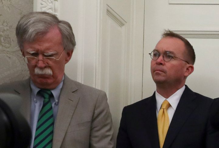 By the same 53-47 party-line, Republicans turned away witnesses with front-row seats to Trump's actions including acting John Bolton (left), the former national security adviser critical of the Ukraine policy, and White House chief of staff Mick Mulvaney (right).