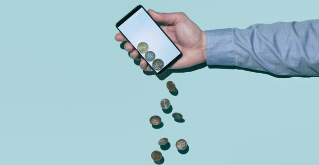 Coins falling out of a smart phone (digital