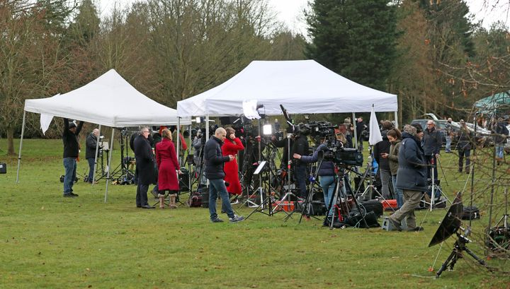 Members of the media gather Sandringham Estate during the crisis talks over Meghan and Harry's exit.