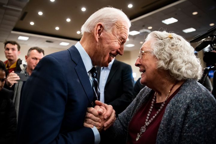 Former Vice President Joe Biden speaks with an older voter in Ames, Iowa, on Tuesday. Progressive groups are going after Bide