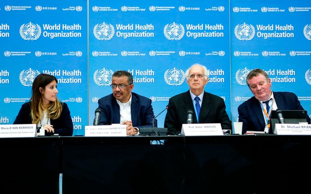 Officials from the World Health Organization sit together for a press conference following an emergency...