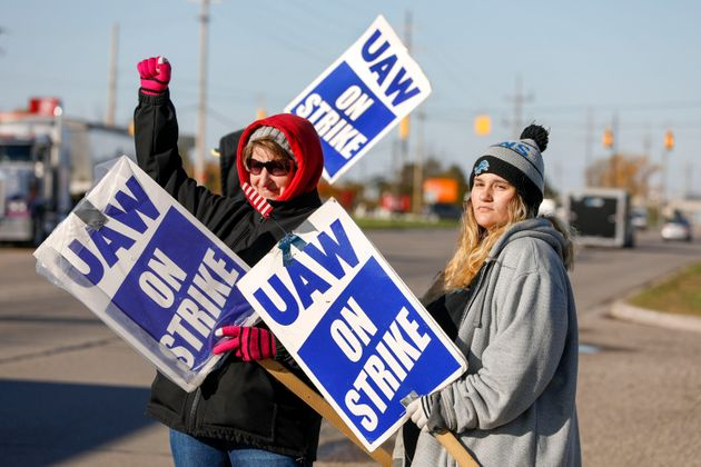 United Auto Workers members on a picket line last year in Flint,