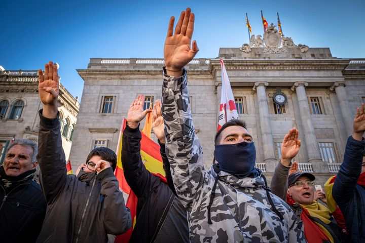 Vox supporters sing the anthem of the Spanish Phalanx while making the fascist salute during a Jan. 12 protest in Barcelona.