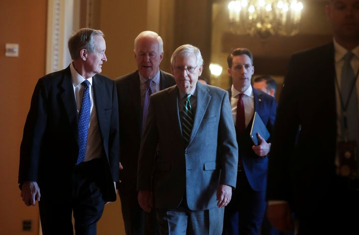 Senate Majority Leader Mitch McConnell and other Republican senators before the procedural start of the impeachment trial of