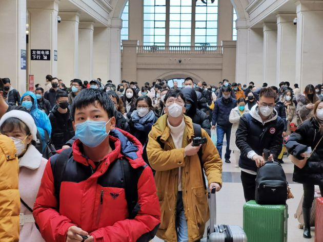 WUHAN, CHINA - JANUARY 22: People wear face masks as they wait at Hankou Railway Station on January 22,...