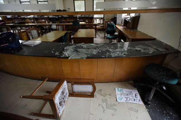 A view of the damaged Jamia Milia Islamia library after police entered the university campus later on...