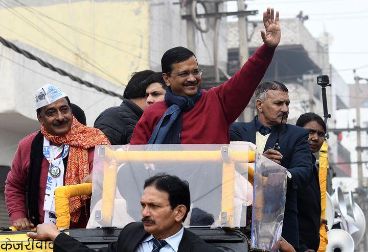 NEW DELHI, INDIA - JANUARY 22: Delhi Chief Minister Arvind Kejriwal waves during a road show ahead of the Delhi Vidhan Sabha elections, at Badli on January 22, 2020 in New Delhi, India.