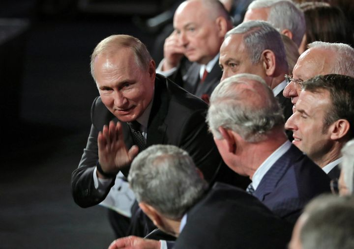 Russian President Vladimir Putin greets fellow world leaders attending the fifth World Holocaust Forum at the Yad Vashem Holo