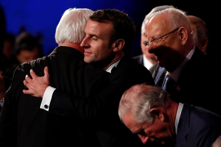 German President Frank-Walter Steinmeier and French President Emmanuel Macron hug at the World Holocaust Forum in Jerusalem,