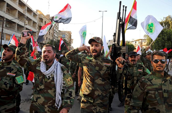 Iraqi Shiites from the Badr forces militia protest against the military intervention in Yemen, in Baghdad, Iraq in 2015. (Pho