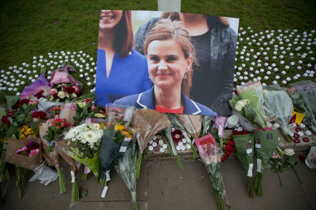 A photo of murdered Batley and Spen MP Jo Cox surrounded by floral tributes in Parliament Square. Former...