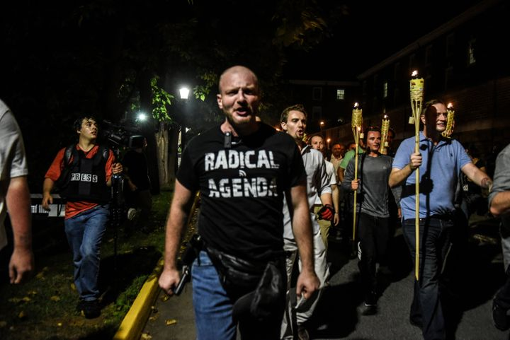 Christopher Cantwell and other white nationalists participate in a torch-lit march on the grounds of the University of Virgin