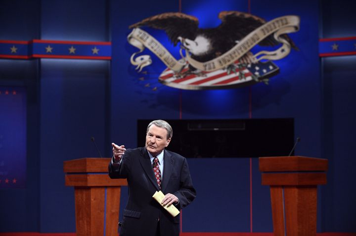 Moderator Jim Leher stands on stage before a presidential debate on October 3, 2012 in Denver, Colorado.