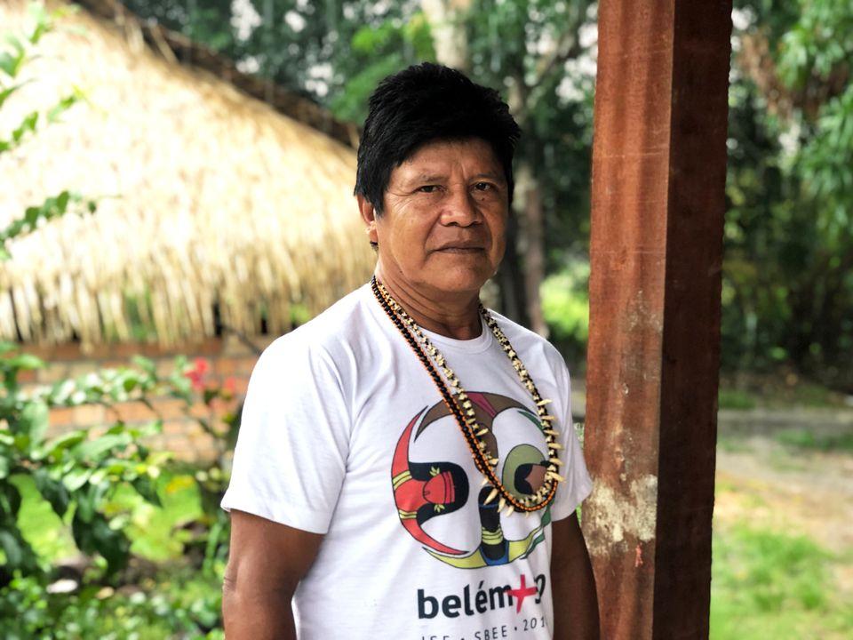 Juarez Munduruku, a tribal chief for the tribe, speaks in an Indigenous neighborhood of