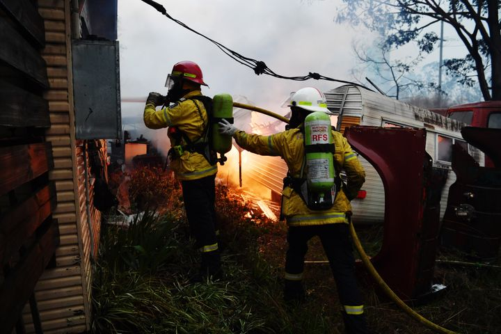 Rural Fire Service firefighters extinguish a fire on a property on January 23, 2020 in Moruya, Australia. (Photo by Sam Mooy/Getty Images)