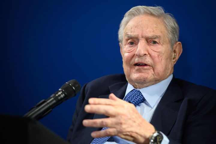 Investor and philanthropist George Soros goes after Donald Trump and Facebook at the World Economic Forum in Davos on Thursda
