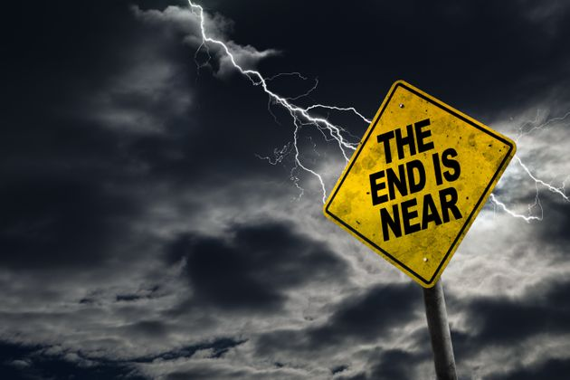 End is Near sign against a stormy background with lightning and copy space. Dirty and angled sign adds...