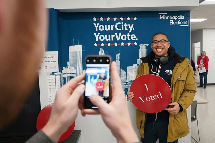 Jared Mollenkof has his photo taken after voting at the Minneapolis Early Voting Center, on Jan. 17, 2020.