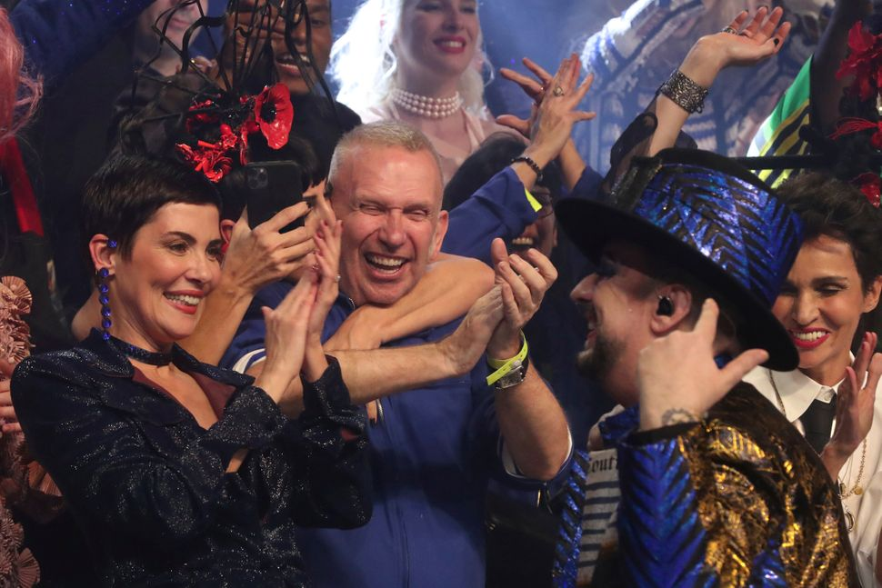 Designer Jean Paul Gaultier, centre, accepts applause from singer Boy George, right, and models after his final Haute Couture Spring/Summer 2020 fashion collection presented Wednesday Jan. 22, 2020 in Paris. Fashion icon Gaultier presented his final couture catwalk collection, the designer's only remaining runway show since putting an end to his ready-to-wear collections in 2014. (AP Photo/Thibault Camus)