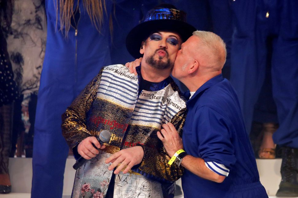 Designer Jean Paul Gaultier kisses Boy George at the end of his Haute Couture Spring/Summer 2020 collection show in Paris, France, January 22, 2020. Picture taken January 22, 2020. REUTERS/Charles Platiau
