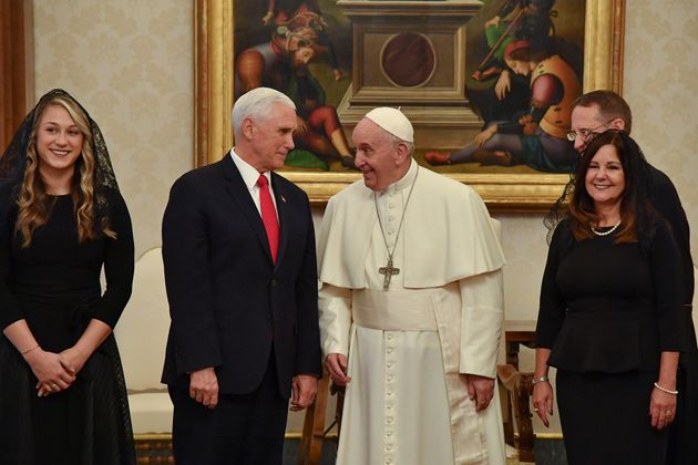 Pope Francis (2nd R) speaks with US Vice President Mike Pence (2nd L) as they pose for pictures with...