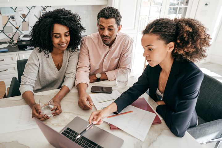 An accountant is seen here explaining mortgage payment options to a couple in this stock photo. There's no right or wrong decision when it comes to what kind of mortgage you choose, but there are pros and cons to each.