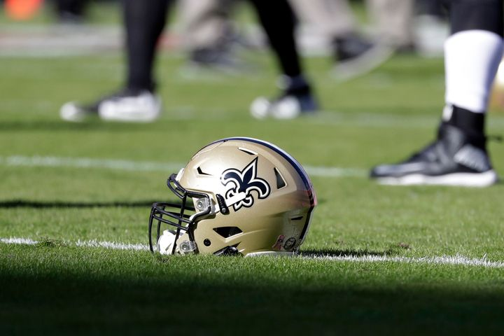 FILE - In this Oct. 23, 2016, file photo, a New Orleans Saints helmet rests on the playing field before an NFL football game