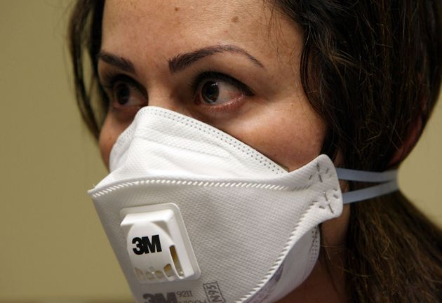 A nurse wears a N95 respiratory mask during a training session April 28, 2009 in Oakland, California...