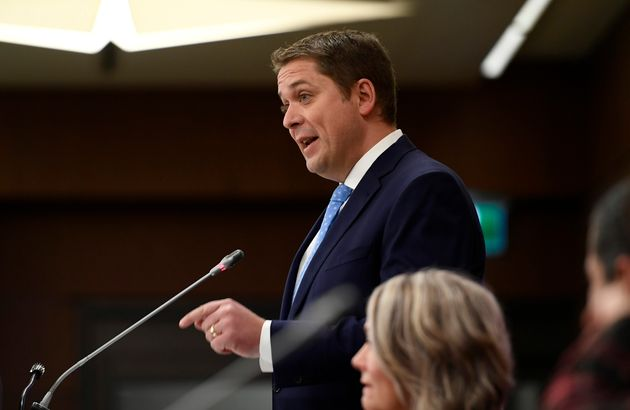 Conservative Leader Andrew Scheer delivers remarks to caucus colleagues during the Conservative caucus...