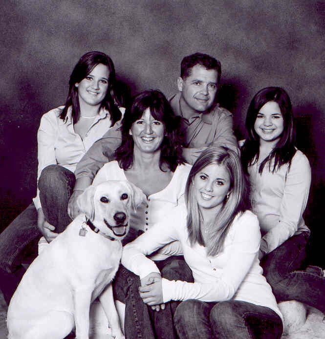 Conservative MP Len Webber, in the back, is shown in an undated photo with his late wife, Heather, their daughters (from left to right) Lauren, Jaime and Kelly, and the family dog, Lucy.