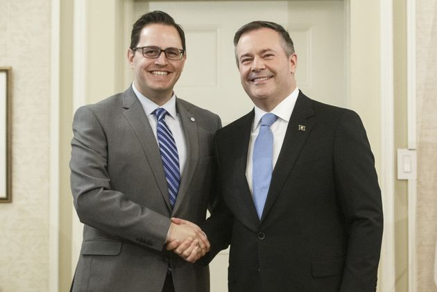 Alberta Premier Jason Kenney shakes hands with Demetrios Nicolaides, Minister of Advanced Education after...
