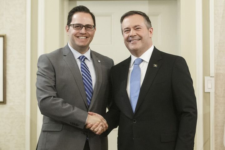 Alberta Premier Jason Kenney shakes hands with Demetrios Nicolaides, Minister of Advanced Education after being sworn into office, in Edmonton on Tuesday April 30, 2019.