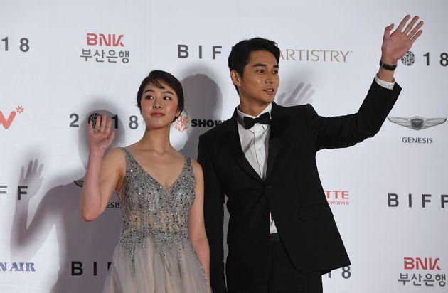 Japanese actor Daichi Watanabe (R) and actress Erika Karata (L) pose on the red carpet during the opening...