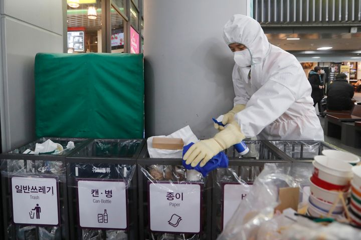 An employee works to prevent a new coronavirus at Suseo Station in Seoul on Friday.