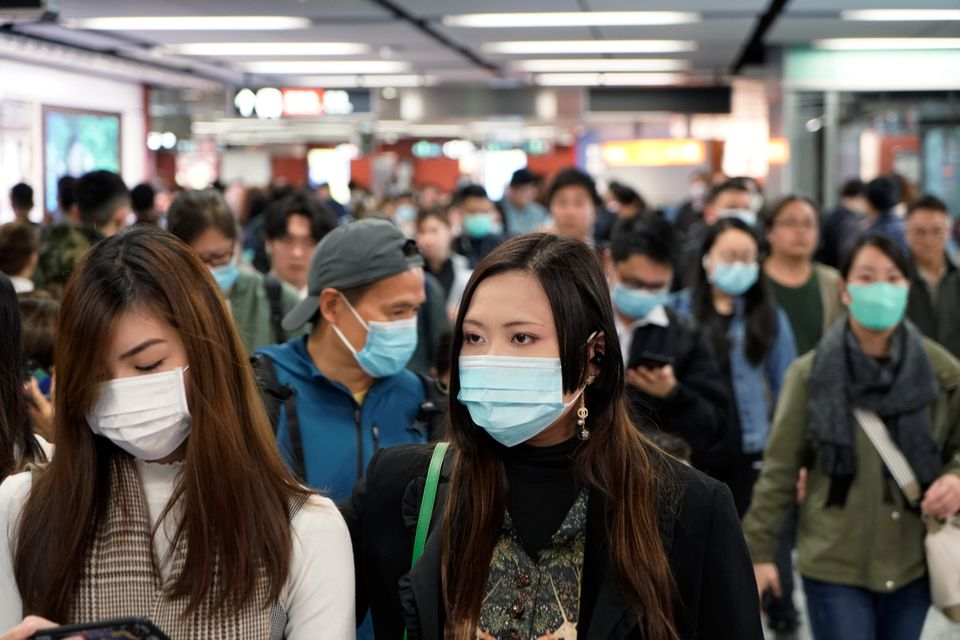 Passengers wear masks amidst an outbreak of a new coronavirus in a subway station in Hong Kong on