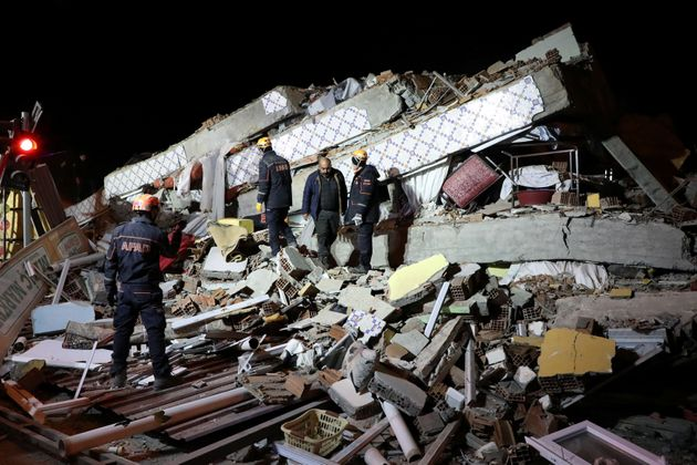 Rescue workers search on a collapsed building after an earthquake in Elazig, Turkey, January 25, 2020....