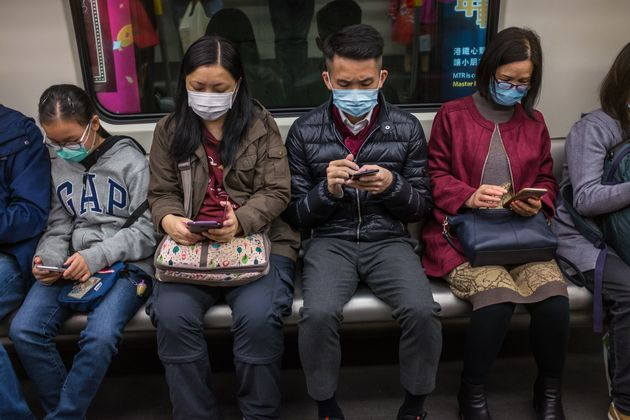 People wear masks on a train on the first day of the Lunar New