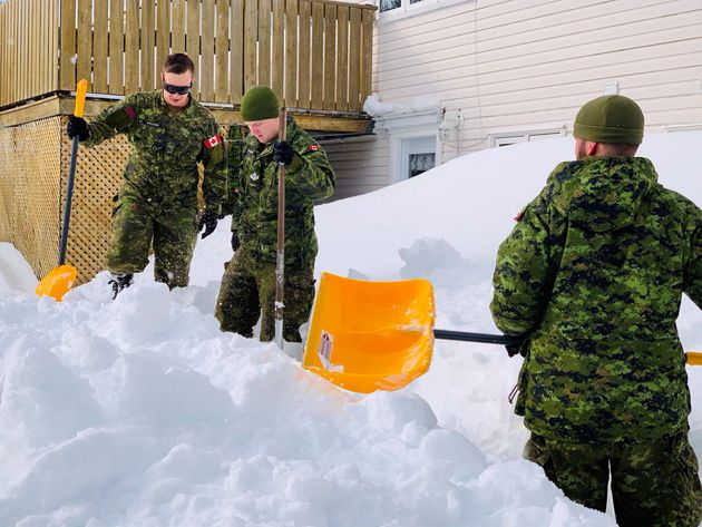 Canadian Forces members help residents with snow removal in St. John's on Jan. 20,