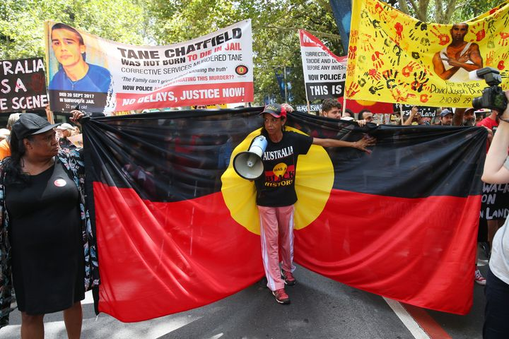 People march down Elizabeth St during the Invasion Day march on January 26, 2020 in Sydney, Australia.