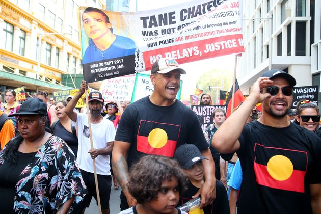 Latrell Mitchell  marches down Elizabeth St during a protest march on January 26, 2020 in Sydney, Australia.